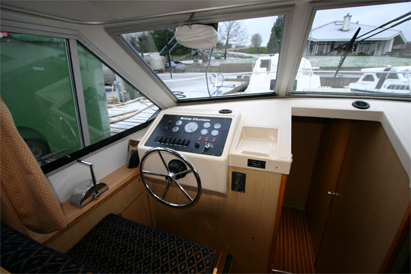 The Helm on the Fermanagh Class Cruiser - Shannon River Boat Hire Ireland