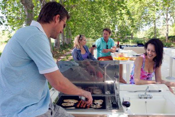 Barbecue on the Sundeck of the Vision 3 Hire Cruiser